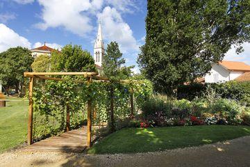 Mimizan - ville - visite - 4 fleurs - centre ville - patrimoine - jardin public - église - clocher proche - musée prieuré - aire de jeux